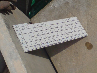 Broken Aspire Keyboard drying in the sun